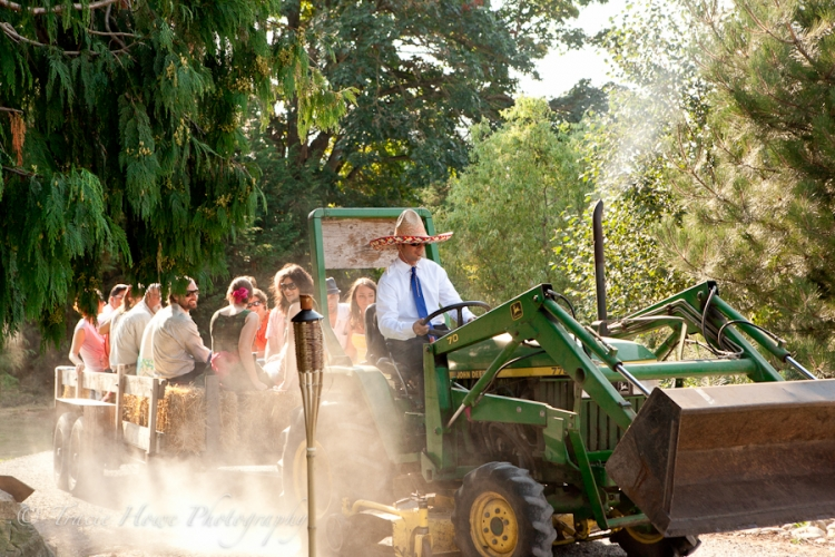 Photo of guests arriving at a wedding on a tractor