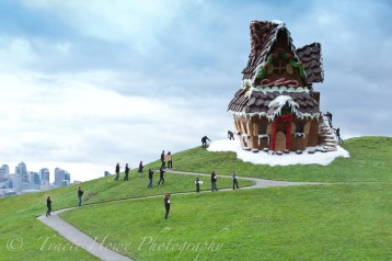 Forced perspective photo of giant gingerbread house on hill at Gasworks Park