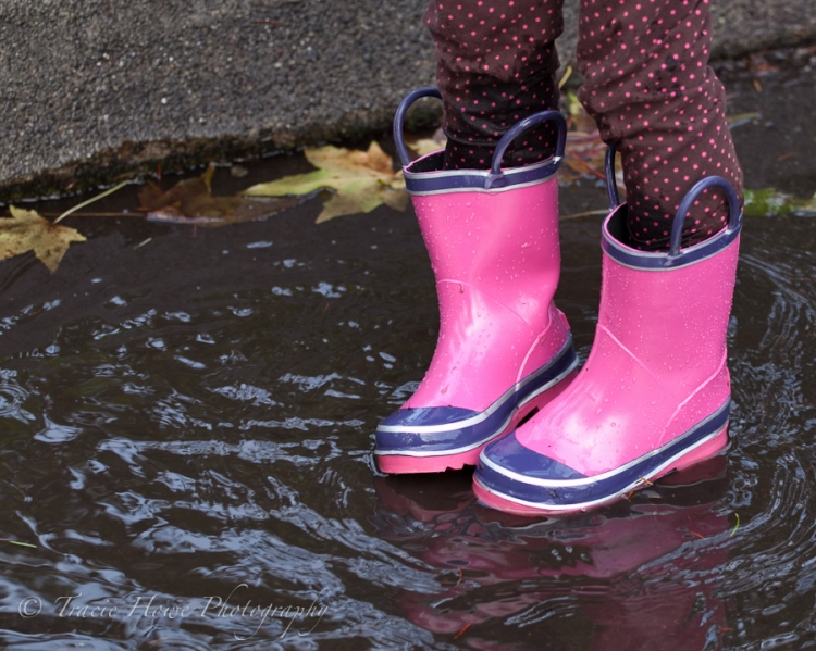 photo of girl standing in puddle with boots