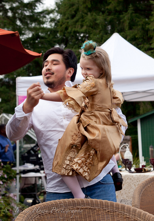 Cute photo of guy dancing with little girl at wedding