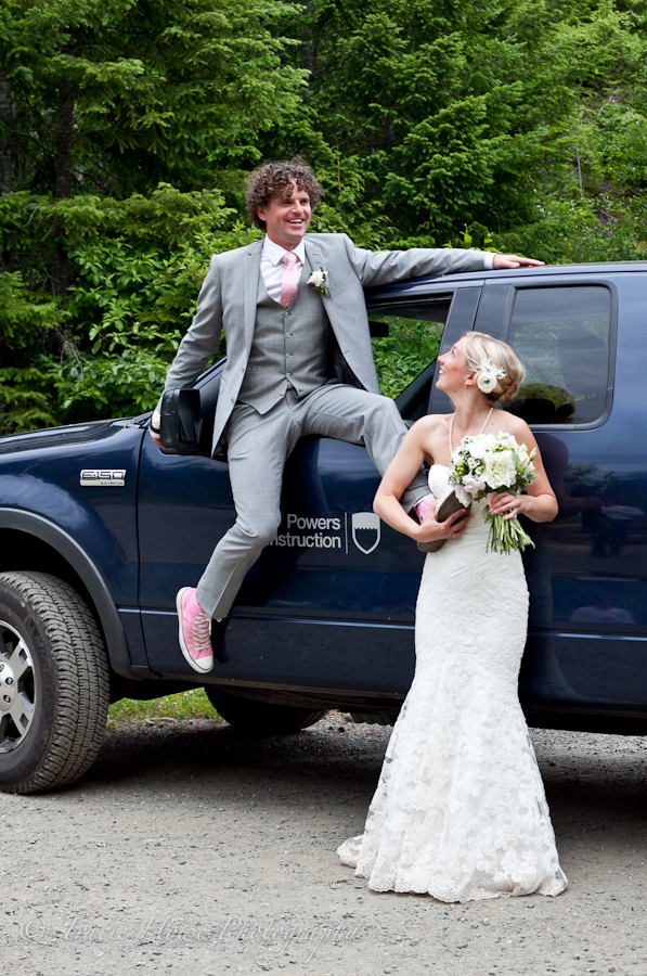 Bride and groom doing an unconventional pose