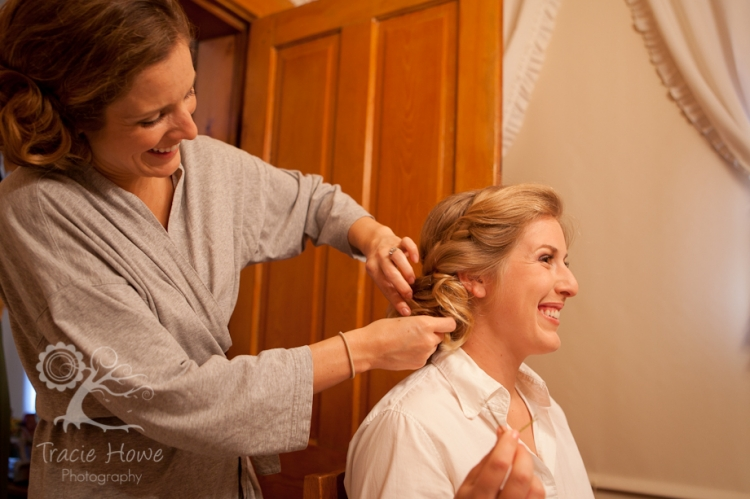 Sister helping bride get ready